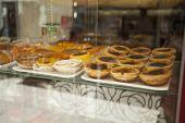 image of custard  - Custard tarts in a shop window in Lisbon - JPG