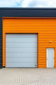 picture of front-entry  - orange warehouse front view and orange facade - JPG