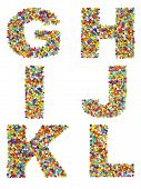 stock photo of beads  - Letters of the alphabet G through L made from colorful glass beads on a white background - JPG