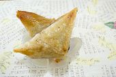 foto of baklava  - Triangle shaped Turkish Baklava on a plate with decoupage background - JPG