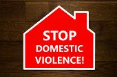 foto of domestic violence  - Stop domestic violence message over wooden background - JPG