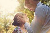 foto of flirt  - Young romantic couple flirting in sunshine - JPG
