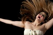 pic of nose ring  - Girl In Lighting Makeup Celebrating with arms out and crazy hair - JPG
