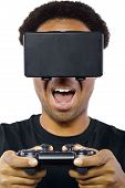 picture of controller  - Black male wearing a virtual reality headset and controller on white background - JPG