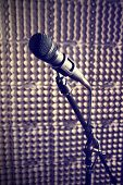 foto of stand up  - Modern microphone on a stand recording studio microphone DSLR picture sound wall microphone stand mesh wire close - JPG