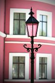 image of building relief  - Beautiful lantern on a background of an old building - JPG