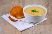 stock photo of bread rolls  - Fish chowder soup including smoked haddock cod salmon and vegetables served with a bread roll - JPG