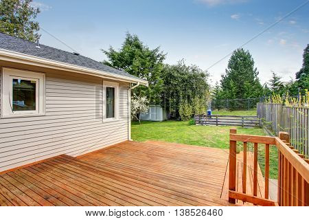Picture Of Large Wooden Back Deck.