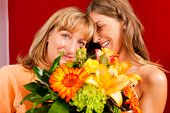 Mother and daughter �¢�?�? the daughter has given her mother flowers