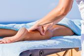 chiropractic massage therapy woman at sea resort poster