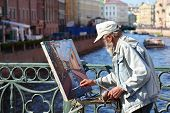 SAINT-PETERSBURG - MAY 21: Unidentified painter paints on Nevskom prospectus, May 21, 2010 in Saint-