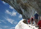 Four person on trek in rock
