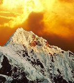 Beautiful peak Alpamayo on sunset