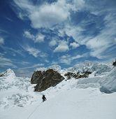 Climber the climb on Alpamayo peak