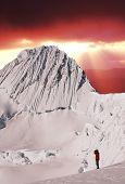Climber looking on Alpamayo peak