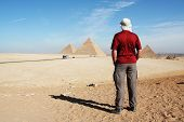 Man looking on pyramids