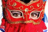 Closeup Of Beautiful Woman Wearing Fancy Red Mardi Gras Mask With Gold Studs And Red Lace With Hazel