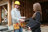 image of woman couple  - A woman home owner shaking hands with the construction worker - JPG