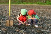 Little children with shovel