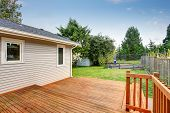 Picture Of Large Wooden Back Deck. poster