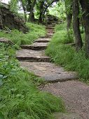 stock photo of stepping stones  - rock steps leading up a path in a minnnesota park - JPG