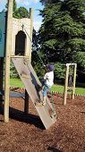 Boy Climbing Frame/Wooden Structure. Child Playing
