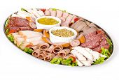 stock photo of cabana  - cold meat catering platter with cold cuts of meat including sliced chicken breast mortadella salami roast beef ham turkey cabana sausage and seeded wholegrain mustard and sweet mustard pickle - JPG