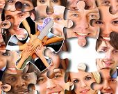 foto of brain-teaser  - Group of business people in pieces of a puzzle - JPG