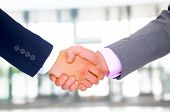 Business men hand shake in the office