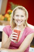 Woman Drinking A Berry Smoothie