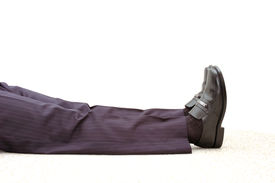 picture of peg-leg  - The legs and feet of a dead businesman stretched out against a white background  - JPG