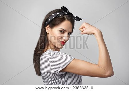 poster of Picture Of Confident Attractive Young Woman With Dark Loose Hair And Athletic Slim Body Posing Isola