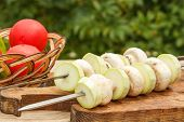 Zucchini And Mushrooms On Skewers With Tomatoes In A Wicker Basket. Vegetable Marrows And Mushrooms  poster