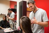 Smiling Male Hairdresser Cutting Hair