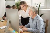 Female Executive Teaching Senior Colleague Explaining Computer Work, Corporate Teacher Helping Focus poster