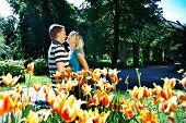 Man And Girl Among Flowers