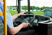 picture of bus driver  - Bus driver sitting in his bus on tour - JPG