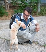 Man Playing With Little Dog