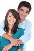 stock photo of pubescent  - Teenage couple stood in studio - JPG