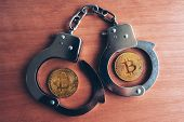 Handcuffs And Bitcoins, Conceptual Image For Cryptocurrency Related Police Arrest poster