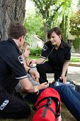 stock photo of triage  - Emergency medical service attending to a injured patient - JPG