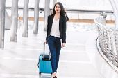 Happy Successful Business Woman Walking With Luggage poster