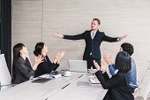 Successful Business People Clapping Hands In The Meeting poster