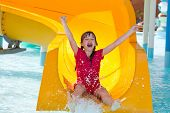 Happy girl on waterslide
