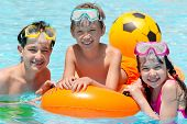stock photo of floaties  - Children playing in pool - JPG