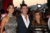 LOS ANGELES, CA - SEPTEMBER 14: Nicole Scherzinger; Simon Cowell; Paula Abdul at the premiere of Fox's 'The X Factor' at ArcLight Cinemas Cinerama Dome on September 14, 2011 in Los Angeles, California