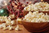 Christmas still life of popcorn being strung together to create garland for the tree.  Decorations a