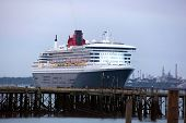 SOUTHAMPTON, UK - 5 JUNE: Cunard ships Queen Mary 2 & Queen Victoria meet in the port of Southampton