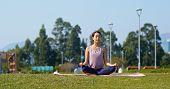 Woman do yoga at park poster