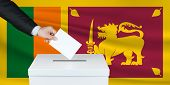 Election In Sri Lanka. The Hand Of Man Putting His Vote In The Ballot Box. Waved Sri Lanka Flag On B poster